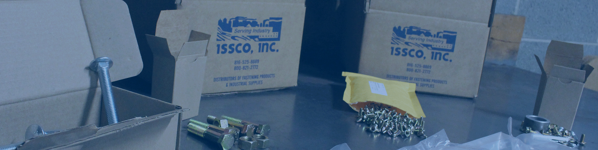 ISSCO boxes containing fasteners on a table