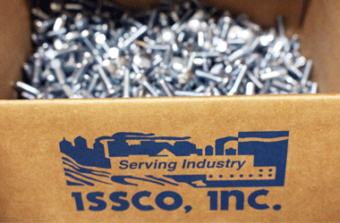 an opened box of fasteners